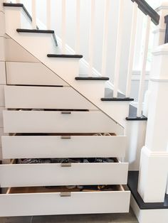 Hidden drawers below staircase