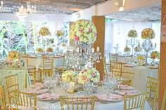 Wedding guest table decor with lush fresh flowers in Kukua Punta Cana, Dominican Republic  Photo by Milan Photo Cine Art
