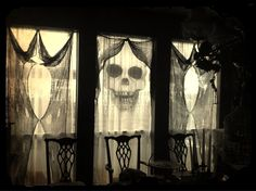 Use black cheese cloth as spooky yet classy curtains for Halloween decorations.