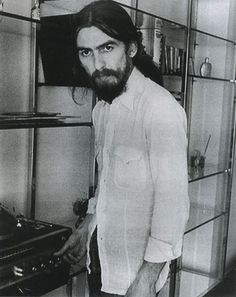 George Harrison, enjoying his record player