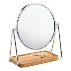 See and store more with our 1X/5X Swivel Mirror & Oak Tray. Its mirror pivots 360° to just the right angle for you, and its 5X magnification ensures that you'll see clearly. It comes with a beautiful removable oak tray that fits just below the mirror and rests on its stand. You can place your jewelry or a few finishing beauty products on it.