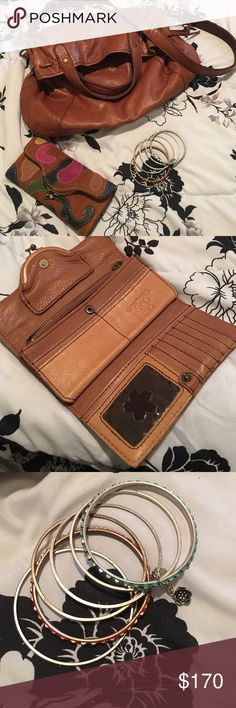 Lucky Lot Lucky brand purse with bangles and matching wallet!! I will sell separately! Let me know or take the lot! EUC. NO STAINS RIPS OR DAMAGE. Bag is a large cross body. Lucky Brand Bags Crossbody Bags
