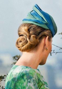 Belgian Queen Mathilde's hair and hat details during Antwerp visit.