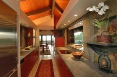 Beautiful Use Of Stone...and Love The Red Cabinets!
