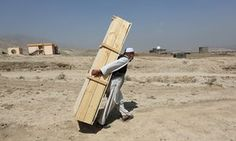 A man carries an empty casket to a funeral ceremony for victims of an Islamic State suicide bomber who killed at least 80 people taking part in a peaceful Shia Hazara demonstration in Kabul, Afghanistan Pictures Of The Week, Cool Pictures, Funeral Ceremony, A Moment In Time, Daily Star, Outdoor Chairs, Outdoor Decor, Nbc News, Casket