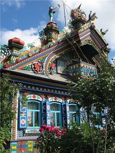Front part of the house decorated by the Russian blacksmith, Sergey Kirillov, begun in 1954, completed in 1967.