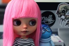 My first baby! She is a factory Blythe and has the following work done: -Sanded -Carved nose and lips -Makeup using pastels and pencils, sealed -Boggled Eyes -Gaze correction -Painted lids -Custom chips made by myself -New Lashes -Sleepy eyes. -Pullrings made by me <3  Phew!