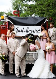Fire fighter wedding pics on back of the fire truck