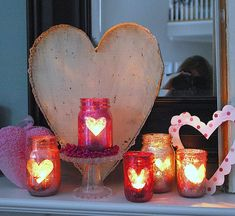 Light a flame this Valentines Day with these adorable sparkly candle holders! They're so cute and so easy to make! #valentinesdayparty