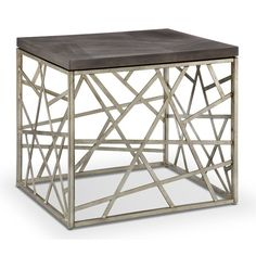 Like its big apple namesake, Hiettis the ideal selection for uptown chic. Abstract art forms crafted of metal and finished in distressed silver create stunning bases while birch veneer wood tops, finished in smoke gray make a dramatic contrast to the random geometric pattern of the bases in the simple cube shapes of the square end table and rectangular cocktail table. Completing the collection is the statement sofa table, perfect as a standalone accent piece. Constructed using solid wood and…