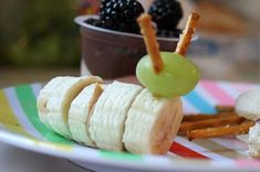Peanut butter, sliced bananas, a grape and pretzel sticks become a tasty and creepy crawly snack.