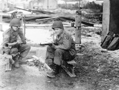 December 31, 1944, Pvt Robert W Bell (left) and PFC Charles W McCall - 139th Airborne Engineer Battalion are guarding a road leading to the village of Douzy (near Sedan, France) (NARA)
