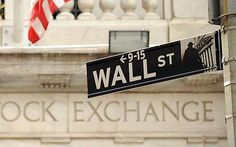 Wall Street sign outside an entrance of the New York Stock Exchange