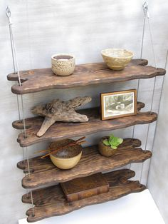 driftwoodinspired hanging shelving display by designershelving - cool idea!                                                                                                                                                      More
