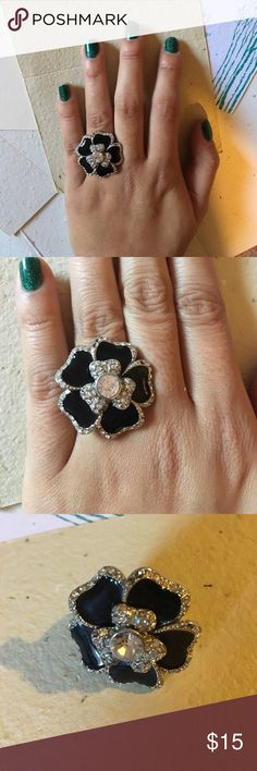 Lia Sophia flower ring Lia Sophia black enamel and rhinestone ring. Wonderful cocktail ring. Some of the rhinestones are missing but it still looks great on! Size 6. Worn a handful of times. No trades. Lia Sophia Jewelry Rings