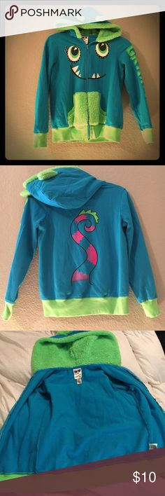Kids Monster Hoodie Cute Monster Hoodie needs a new home. Worn for about 6 months before outgrowing. Teal green with green trim and furry hoodie lining. Monster tail on the back and GRRRR!! written on the left sleeve. Size L. Jackets & Coats