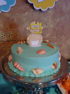 Under the Sea Themed Baby Shower: Baby Cake...like the baby on top and cake pops to the right