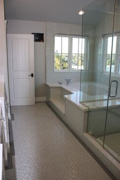 Neutral/cool bathroom with glass walk-in shower.