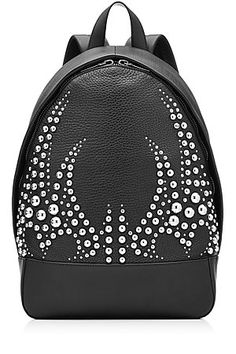 Edgy and urban, this textured leather backpack is embellished with tough silver-tone studs, lending Alexander Wang's signature cool spin to a classic silhouette. The black color makes it versatile despite its edgy finish #Stylebop