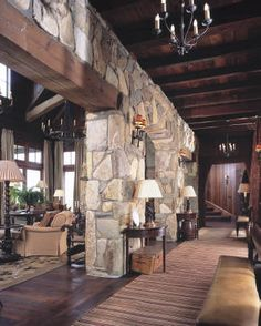 Interior stone walls, wood beams...cozy and rustic.