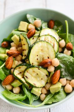 Skin Beauty Salad    230g cooked chickpeas (or use 1 tin)  2 big handfuls of baby spinach leaves  1/2 avocado, diced  small handful of almonds, soaked in water overnight  1 zucchini, sliced into 1/2 cm disks  olive oil, for brushing  2 tablespoons unhulled tahini (or use this recipe)  1/2 lemon, juiced  water  pinch of salt  1 small garlic clove  freshly ground black pepper