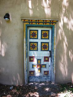 Painted door at the Los Luceros estate, north of Espanola, NM.