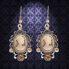 These lovely brown Cameo medieval jewelry earrings have an antique finish and faux crystals. Matching necklace available.  Also comes in silver finish. #earring   #medievaljewelry