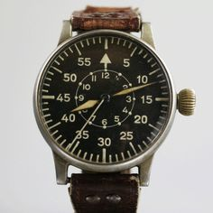 A. Lange & Sohne original WWII Luftwaffe Beobachtungsuhr, or B-uhr, Type B navigator's watch.  Case diameter 55mm. Movement: Lange & Söhne cal. 48/1. Marked on the back with FL 23883 (FL = flight, 23 = navigation). Regulated and tested chronometer.  As Luftwaffe property, they were issued to observers before a flight and returned upon landing.  Approx. 1,200 were made before watch factory was bombed to rubble.