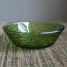 Mamaw would serve me her delicious home grown frozen strawberries in bowls just like this. Vintage Anchor Hocking Soreno Green Glass Bowl by sariloaf
