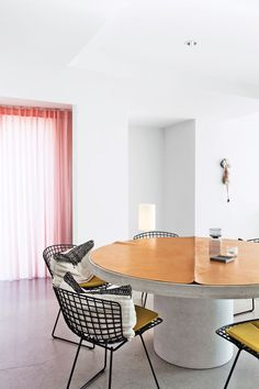 Modern dining room area with steel chairs by Harry Bertoia for Knoll