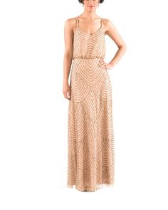 Stylist NotesThis dress makes an awesome Maid of Honor dress, adding a little sparkle to your bestie's look! -Mary KateDescriptionAdrianna Papell Art Deco Beaded Blouson Gown in Taupe PinkFulllength bridesmaid dressVnecklineSpaghetti strapsNaturalwaistBeaded meshNeed it sooner? Ask your stylist for in-stock availability!