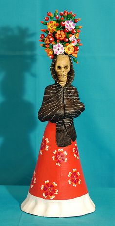 Skeleton with Flowers  Ceramic art for the Days of the Dead by Concepcion Aguilar of Ocotlan, Oaxaca Mexico