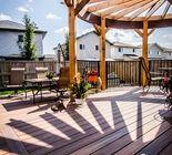 Round Fiberon Pergola, Deck and Railing | By: Paramount Custom Decks Inc. | Sherwood Park, AB
