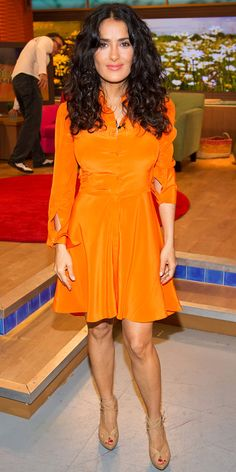 Salma Hayek promoted her new movie Grown Ups 2 in a lovely long-sleeve citrus frock that she styled with nude strappy peep-toes.