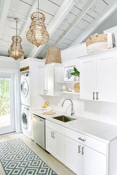 Bright white kitchen in this beach home remodel. Small spaces means the washer and dryer is in the kitchen! Bright white kitchen in this beach home remodel. Small spaces means the washer and dryer is in the kitchen! White Beach Houses, Tiny Beach House, Small Beach Houses, Beach House Bathroom, Beach Bathrooms, Beach House Decor, Beach House Kitchens, Home Kitchens, Small White Kitchens