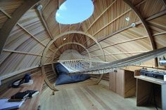 Interior of the Exbury Egg, the floating wooden home to artist Stephen Turner on the Beaulieu River in England.