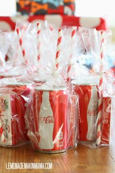 Simple favors to go: mini Coke cans + stripey straw + pack of (red) gum, all tied up with red baker's twine in a cello bag. {Lemonade Makin' Mama}