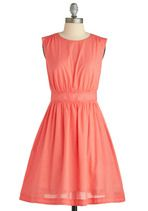 Too Much Fun Dress in Grapefruit    Gathered waist, a line w/ pickets, shoulder details