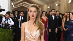 """Amber Heard attends the """"Manus x Machina: Fashion In An Age Of Technology"""" Costume Institute Gala at Metropolitan Museum of Art on May 2, 2016 in New York City. Amber Heard is hitting back at haters who called her a gold-digger after she filed for divorce from Johnny Depp — and she's giving back to...  #JohnnyDepp #AmberHeard #DomesticViolence #Abuse #CelebNews #CelebGossip #EntertainmentNews #ENews"""