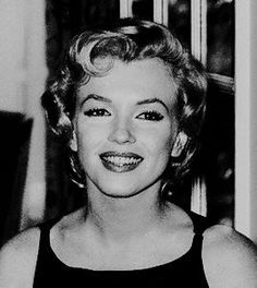 """Marilyn at a press conference for """"The Prince and The Showgirl"""" at the Savoy Hotel, London, July 15th 1956."""