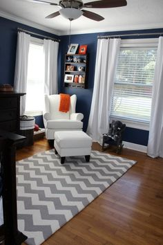 Boy's room - I like the orange accents!  I have always wanted a navy room. Maybe an accent wall in My boy's new room.