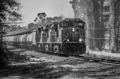 https://flic.kr/p/qYbQAM | Pollard Alabama | K097 rolls north after turning its engines at flomaton. The lighting was horrible so I converted to Black and White