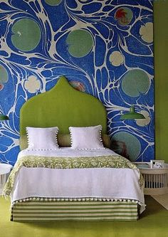 lilly pad marbled wallpaper and avocado upholstered ethnic-shaped headboard bedroom