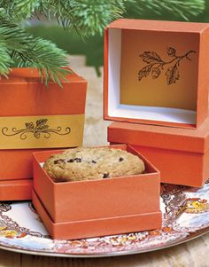 Thanksgiving Favors  Small gift boxes are perfectly sized to send cookies to go. To personalize them, stamp designs on colored cardstock and glue inside the lid. Seal each box with a strip of matching paper with a coordinating design.