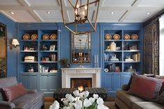 blue painted built ins, brass lantern