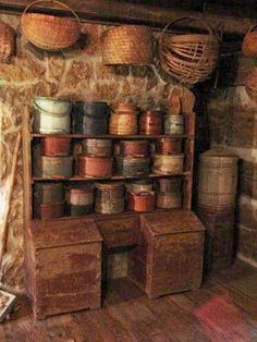 Prims...chippy red cupboard, painted firkins, & tattered baskets.