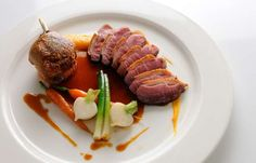 Learn how to Pan roast duck breast with sweet potato fondant, baby vegetables and cherry brandy sauce.Recipes from Great British Chefs.com