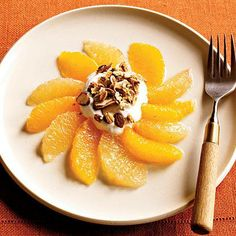 #BREAKFAST: Greek yogurt, low-fat granola, and slices of grapefruit and orange come together for a sweet and satiating morning meal.