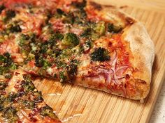 """caramelized broccoli and red onion pizza: """"I'm talking broccoli with charred edges and an intensely sweet, nutty flavor. Broccoli that goes on raw and comes out barely cooked through, crunchy in the center."""""""