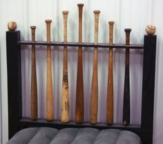 Baseball headboard: drill the holes first, cut the board in half, put it back together and hide the seam. The bats are spinnable by putting a nail up through the bottom.